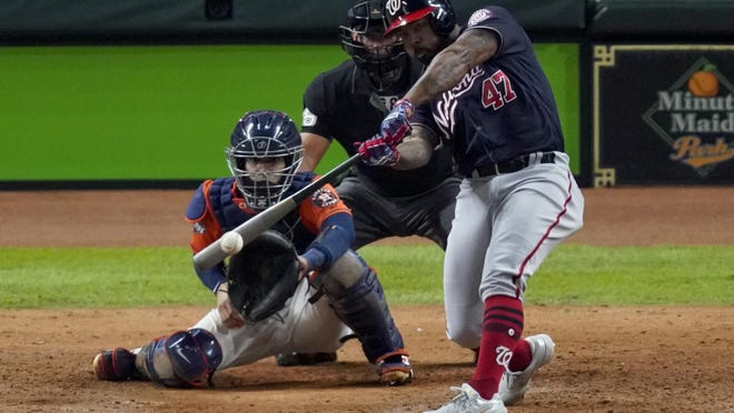 FILE - In this Oct. 30, 2019, file photo, Washington Nationals' Howie Kendrick hits a two-run home run against the Houston Astros during the seventh inning of Game 7 of the baseball World Series in Houston.