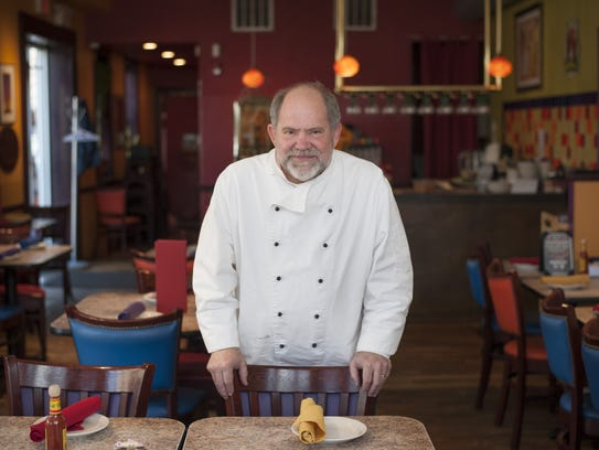 Chef Mark Smith stands in the dining room at his restaurant,