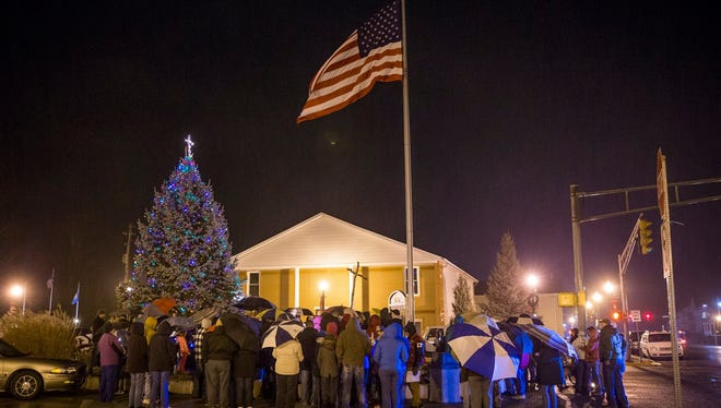 Knightstown residents gathered at the town Christmas tree topped with the controversial cross, Dec. 11, 2016.