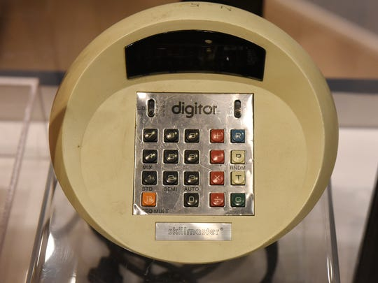 "A vintage calculator is part of the ""Navigating the 70s"" display at the Stearns History Museum."