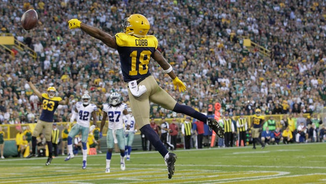 Green Bay Packers wide receiver Randall Cobb is overthrown in the end zone by quarterback Aaron Rodgers.