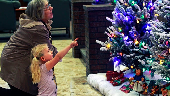 Avery Heding of Brookfield takes in one of the Christmas scenes with her grandmother, Lillian Nolan of Fond du Lac, at BMO Harris Bank at 770 N. Water St. in December 2016. The 2017 display is unveiled Monday.