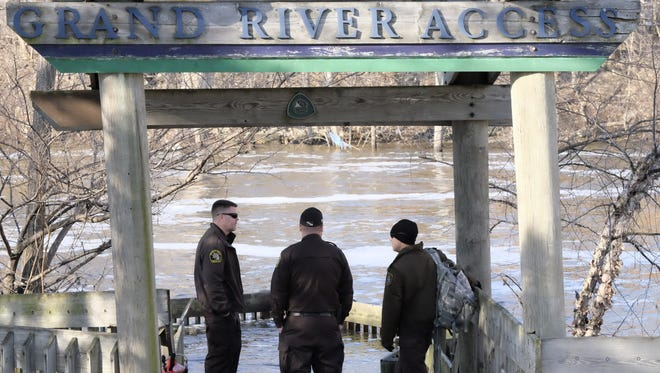 The Capital Area Dive Team continued searching the Grand River near the Brenke Fish Ladder on Wednesday, Feb. 28, 2018 for a kayaker who fell in the river Tuesday evening.