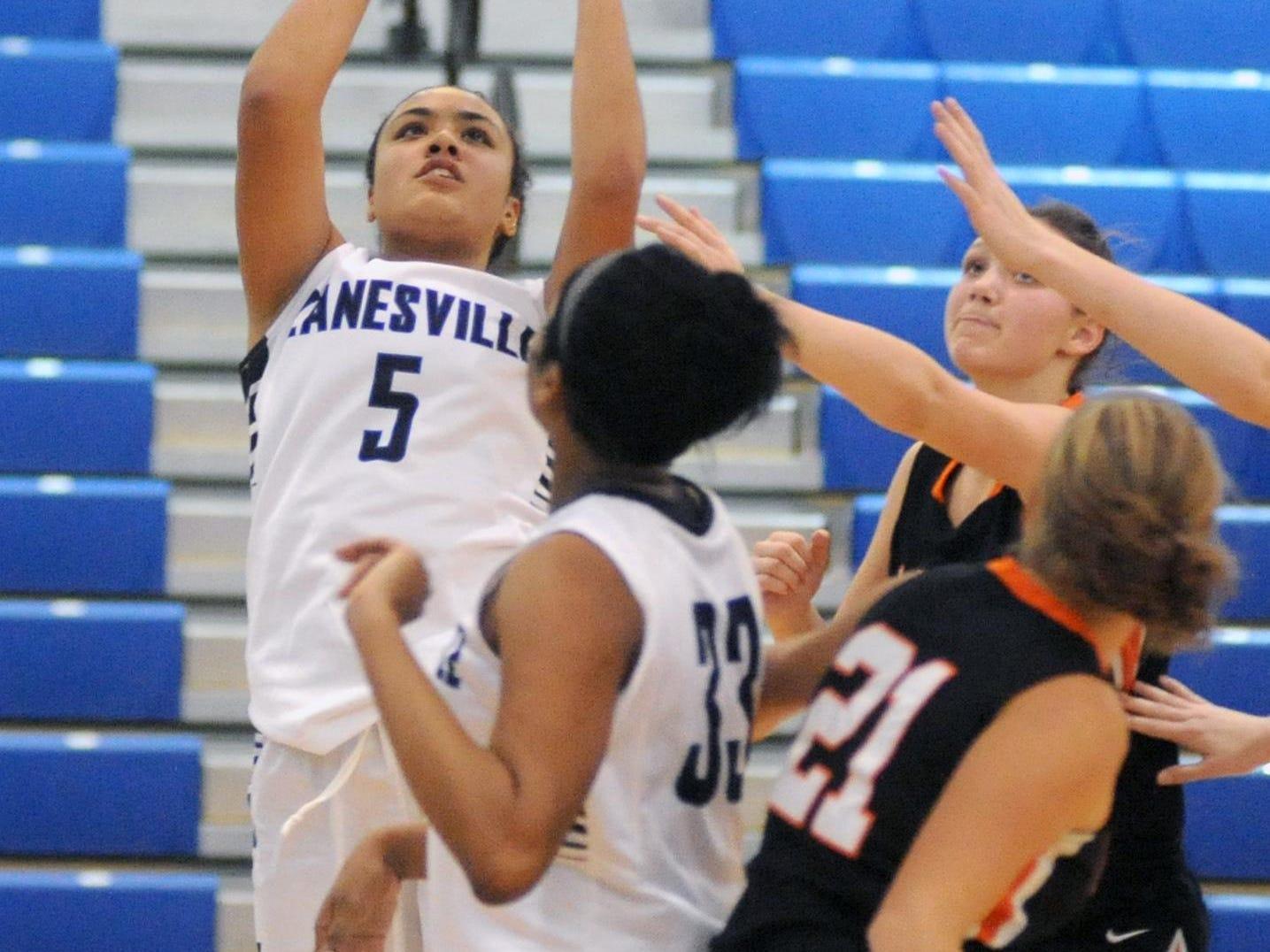 Zanesville's Lexi Draughn puts up a shot during a 46-30 win over Marietta on Saturday in Zanesville.