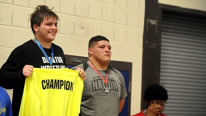 Ean Spencer gets his medal and shirt at the Bayside wrestling championships.