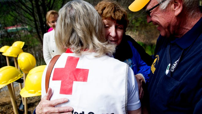 Glenna Ogle hugs Sandra Mulsand and her husband, Lou Mulsand, during a groundbreaking ceremony April 25, 2017, for the rebuilding of her home, which was destroyed in the November wildfires in Gatlinburg. Ogle's home is the first new Gatlinburg home constructed as part of the Mountain Tough effort in conjunction with the Appalachia Service Project and Holston Conference of the United Methodist Church partnership.