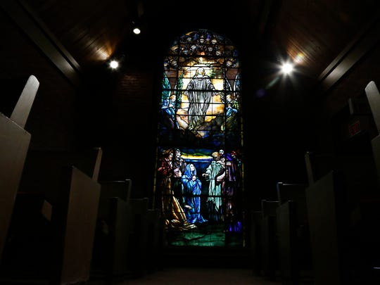 The First Presbyterian Church of Elmira features a Tiffany stained glass window that depicts Jesus' ascension into heaven.