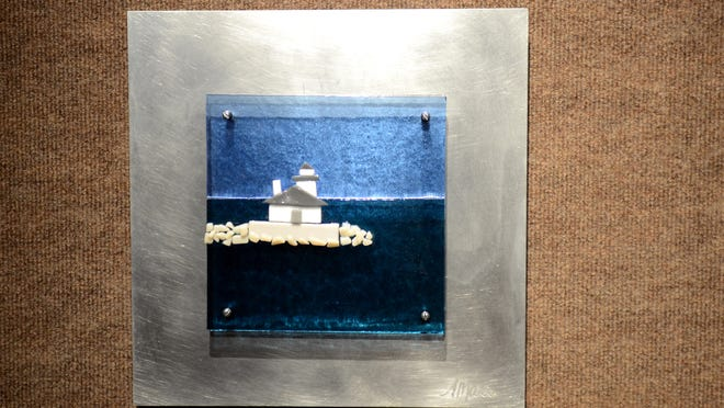 Fused glass artwork by Alysa Diebolt depicting Lake Ontario is displayed Monday, May 11, at her gallery inside the SC4 Fine Arts Building.