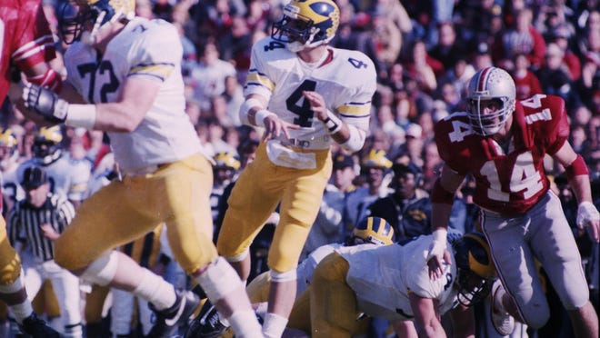 After guaranteeing a victory, quarterback Jim Harbaugh leads Michigan to a 26-24 victory over Ohio State in Columbus in 1986.