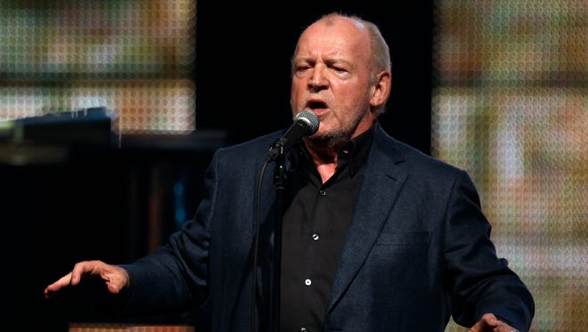 """In this Aug. 5, 2011 file photo, British singer Joe Cocker sings the """"Red Cross Gala"""" in Monaco. Cocker, best known for the songs, """"You Are So Beautiful,"""" and the 1980s duet """"Up Where We Belong,"""" with Jennifer Warnes, died Monday, Dec. 22, 2014 of lung cancer in Colorado. He was 70. (AP Photo/Lionel Cironneau, File)"""