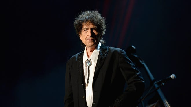 Honoree Bob Dylan speaks onstage at the 25th anniversary MusiCares 2015 Person Of The Year Gala honoring Bob Dylan at the Los Angeles Convention Center on February 6, 2015 in Los Angeles, California. The annual benefit raises critical funds for MusiCares' Emergency Financial Assistance and Addiction Recovery programs. For more information visit musicares.org.  (Photo by Michael Kovac/WireImage) ORG XMIT: 535088427 ORIG FILE ID: 462898048