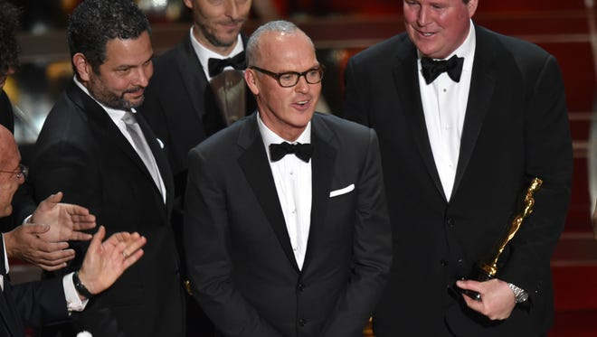 """Star Michael Keaton and the cast and crew of """"Birdman  (or The Unexpected Virtue of Ignorance)"""" accept the award for the best picture at the Oscars on Sunday, Feb. 22, 2015, at the Dolby Theatre in Los Angeles."""