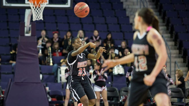 Maricopa senior Tiara Edmond (left) sends a pass down the court to senior point guard Ashleigh Haley during a Division II semifinal basketball game at Grand Canyon University February 27, 2015 in Phoenix, Arizona.