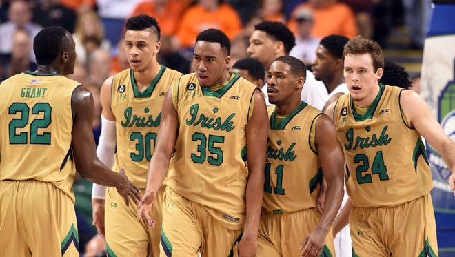 Notre Dame Fighting Irish guard Jerian Grant (22) forward Zach Auguste (30) forward Bonzie Colson (35) guard Demetrius Jackson (11) and guard/forward Pat Connaughton (24) celebrate during game agains the Duke Blue Devils in the first half during the semifinals of the ACC Tournament at Greensboro Coliseum.