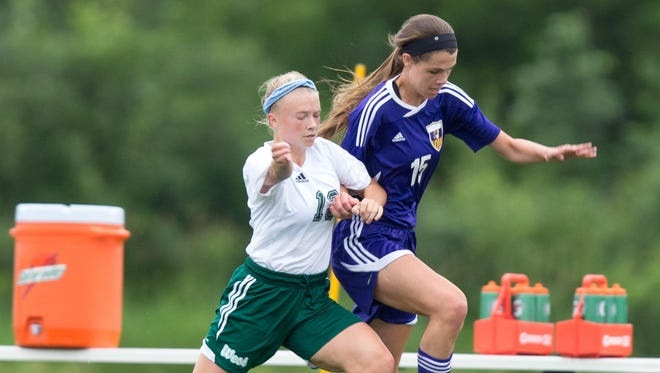 Johnston High School's Emily Lehman and Iowa City West's Emma Cooper collide during the first half Friday, June 12, 2015, during the IGHSAU State Soccer Championships at the Cownie Soccer Complex in Des Moines.