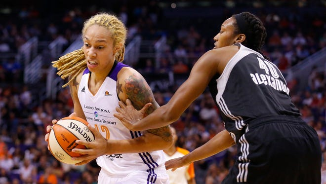 The Mercury's Brittney Griner drives to the basket against San Antonio Stars' Kayla Alexander on Tuesday, June 30. 2015  in Phoenix.