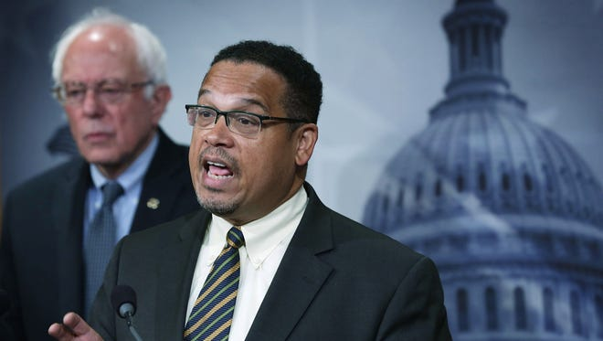 WASHINGTON, DC - SEPTEMBER 17:  U.S. Sen. Bernie Sanders (I-VT) (L) and Rep. Keith Ellison (D-MN) (R) speak to members of the media during a news conference September 17, 2015 on Capitol Hill in Washington, DC. The legislators announced that they will introduce bills to ban private prisons.  (Photo by Alex Wong/Getty Images)