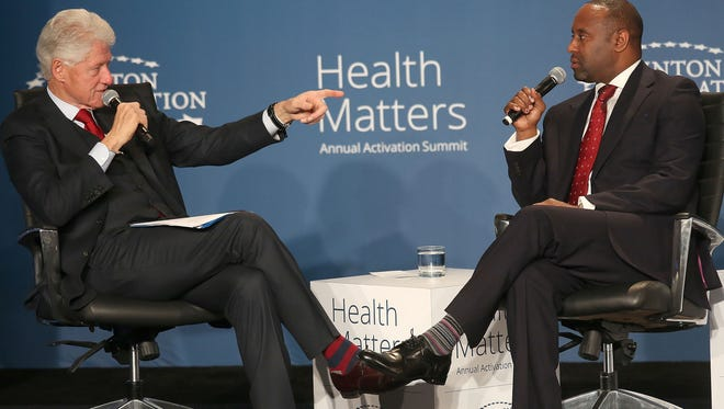 Former President Bill Clinton speaks with Dr. Reginald Eadie, CEO of the Detroit Medical Center, at a panel discussion during the Health Matters Activation Summit in Indian Wells, January 25, 2016.