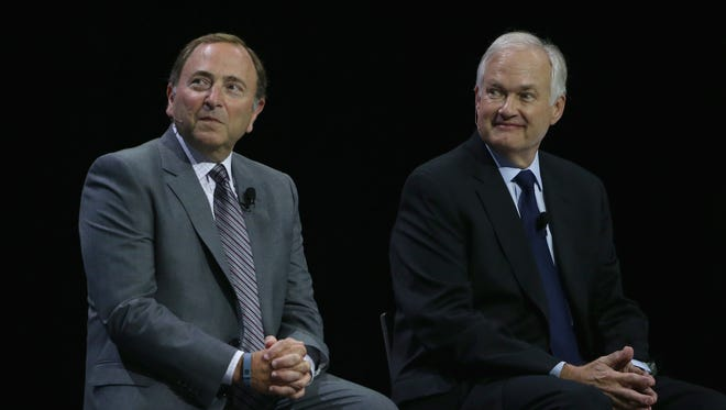 NHL commissioner Gary Bettman (L) and NHLPA executive director Donald Fehr appear on stage together during a press conference in September of last year.