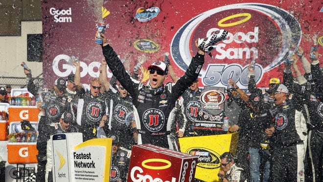 Kevin Harvick  celebrates his win in the Good Sam 500 NASCAR Sprint Cup race at Phoenix International Raceway Sunday, March 13, 2016 in Avondale, Ariz.