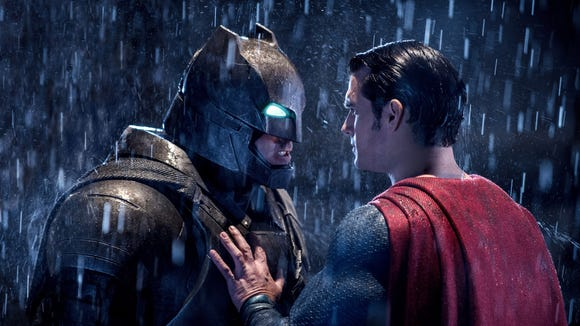 "This image released by Warner Bros. Pictures shows Ben Affleck, left, and Henry Cavill in a scene from, ""Batman v Superman: Dawn of Justice."""