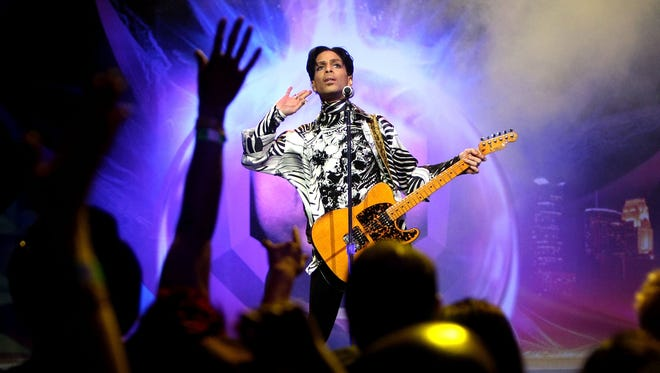 Prince performs his first of three shows onstage during 'One Night... Three Venues' hosted by Prince and Lotusflow3r.com held at NOKIA Theatre L.A. LIVE on March 28, 2009 in Los Angeles