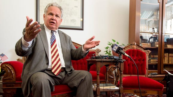 State Auditor Jim Zeigler reacts to Governor Robert