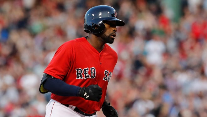 Boston Red Sox center fielder Jackie Bradley Jr. (25) rounds the bases after hitting a home run against the Cleveland Indians in the second inning at Fenway Park.