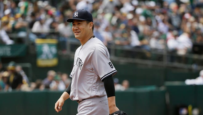 New York Yankees starting pitcher Masahiro Tanaka walks to the dugout after throwing in the sixth inning of a baseball game against the Oakland Athletics Saturday, May 21, 2016, in Oakland, Calif.