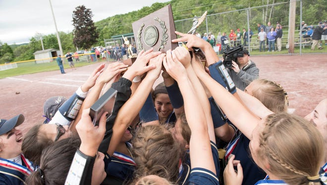 The Essex High School softball team celebrates after winning the Division I crown Monday in Poultney.