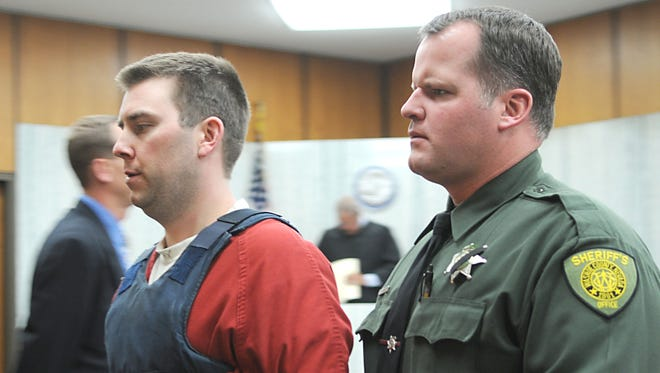 Murder defendant James Michael Biela is led from court May 7, 2010.