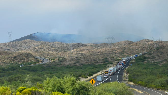 Traffic sits at a standstill along northbound Interstate 17 due to the Bug Creek Fire on Tuesday, June 28, 2016, near Cordes Junction.