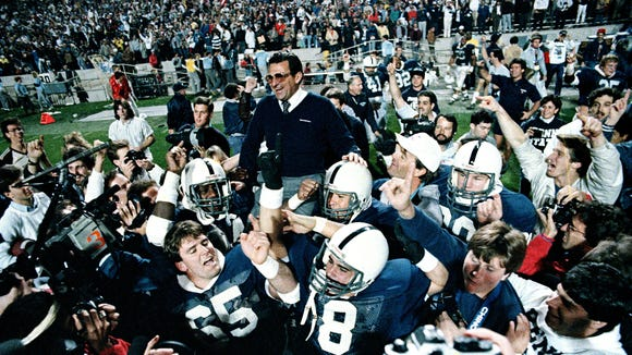 Penn State coach Joe Paterno is carried off the field