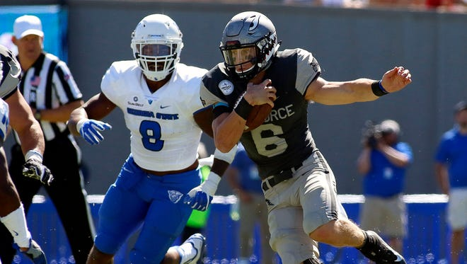 Air Force quarterback Nate Romine scrambles against Georgia State. Georgia State is last in the nation in run defense (394.5 yards per game) and time of possession (19 minutes 25 seconds).