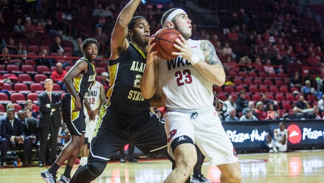 Western Kentucky forward Justin Johnson  posts up on Alabama State forward Mikel Tyson on Saturday in Bowling Green.