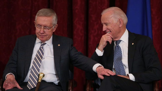 Senate Minority Leader Harry Reid shares a moment with Vice President Biden during Reid's leadership portrait unveiling ceremony on Dec. 8, 2016, on Capitol Hill.