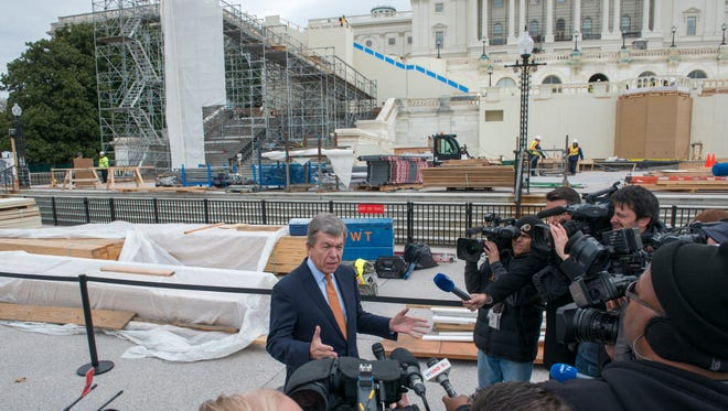 Sen. Roy Blunt speaks to members of the press about the construction of the inaugural platform. Construction continues on the platform for the inauguration of Donald Trump as the 45th president of the United States. The platform will be more than 10,000 square feet and will seat over 1,600 VIP attendees.