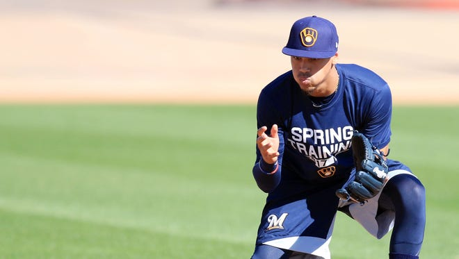 Brewers shortstop Orlando Arcia takes ground balls during infield practice at spring training.