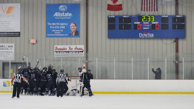 John Jay forward Michael Fischetti score with 2:33 to go in the second overtime, giving the Indians a 1-0 win over Byram Hills in a Division II semifinal at Brewster Ice Arena.
