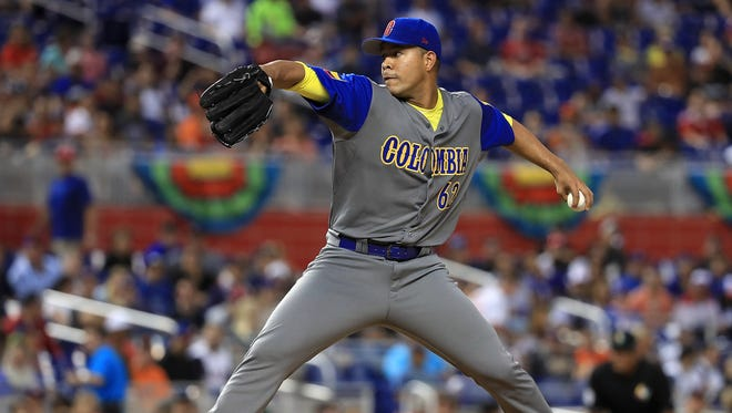 Colombia pitcher William Cuevas pitches during the third inning during a Pool C game of the 2017 World Baseball Classic against the United States at Miami Marlins Stadium on March 10, 2017, in Miami.