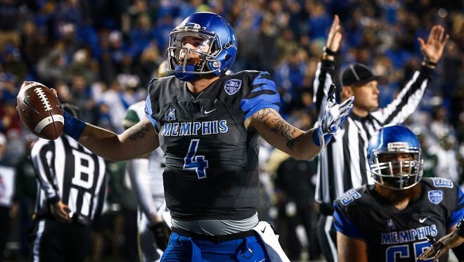 University of Memphis quarterback Riley Ferguson (middle) celebrates a touchdown run against University of South Florida during second quarter action at the Liberty Bowl Memorial Stadium on Nov. 12, 2016.