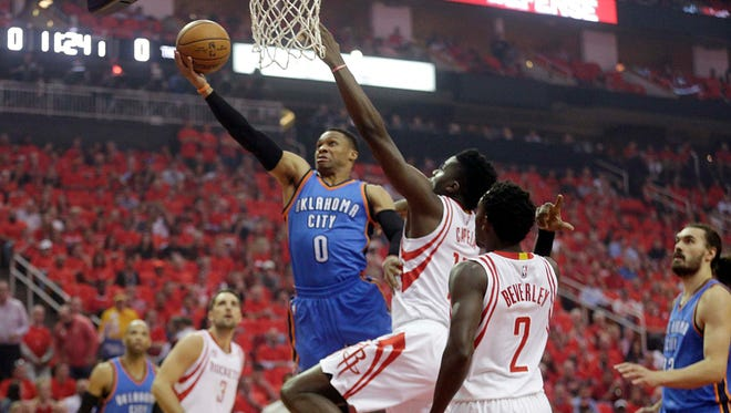 Oklahoma City Thunder guard Russell Westbrook (0) drives against Houston Rockets center Clint Capela (15) in the first quarter in game five of the first round of the 2017 NBA Playoffs at Toyota Center.