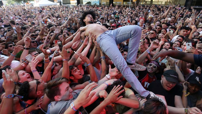 El Pasoan Evander Griiim crowd surfs from the Franklin Mountain Stage after Lil Uzi Vert was a no-show at Neon Desert Music Festival.