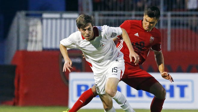 San Francisco Deltas' Maxim Tissot and  Phoenix Rising FC 's Kody Wakasa fight  for the ball in third round of Lamar Hunt U.S. Open Cup Wednesday, May 31, 2017 in Scottsdale, Ariz.