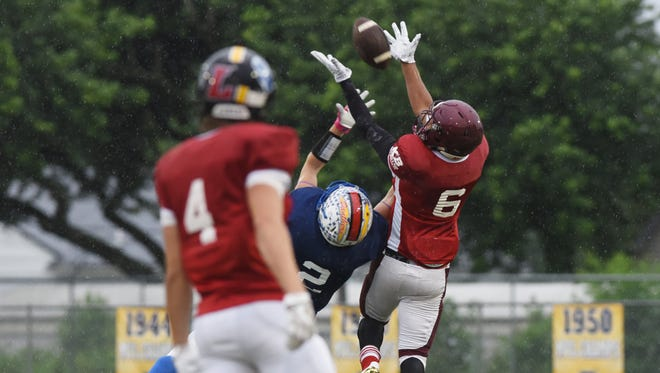 Licking County's Deonte Stradwick intercepts a pass intended for Muskingum Valley's Kolt Moore during the Muskingum Valley-Licking County All-Star Game on Friday.
