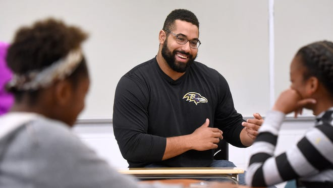 John Urschel, center, seen here in a file photo, has joined the College Football Playoff selection committee.