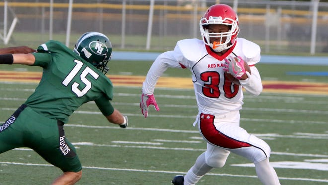 Wauwatosa East's Donovan Hunt sweeps around the end for a gain at West Allis Hale on Aug. 31.