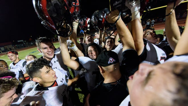 Liberty players celebrate their victory over Centennial after their high school football game on Friday, Oct. 27, 2017, at Centennial High School in Peoria, Ariz.