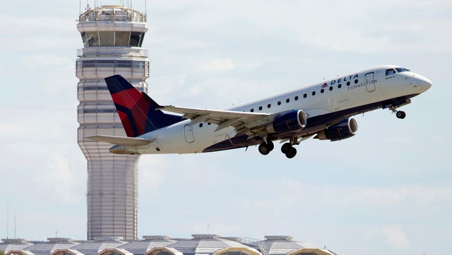 A Delta Air Lines jet takes off July 28, 2014, from Ronald Reagan Washington National Airport in Arlington, Va.