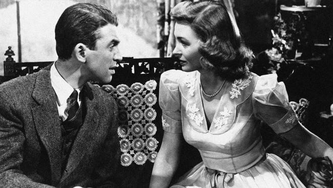"Jimmy Stewart explains things to Donna Reed in Frank Capra's """"It''s a Wonderful Life"","" 1946."